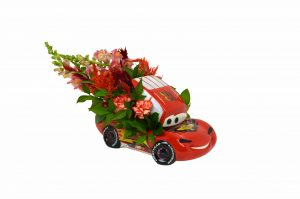 Speed your way into someone's heart with this winning flower arrangement inside the Cars Lightning McQueen Cookie Jar.