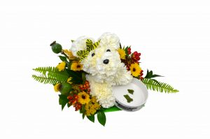 A delightful pooch made out of carnations and other seasonal flowers with a keepsake ceramic dog bowl