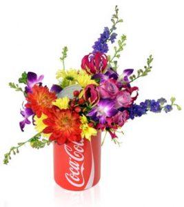 KG1655_COKE_CAN_FLOWERS_LILY_DENDROBIUM_ROSES_LARKSPUR_DAHLIA
