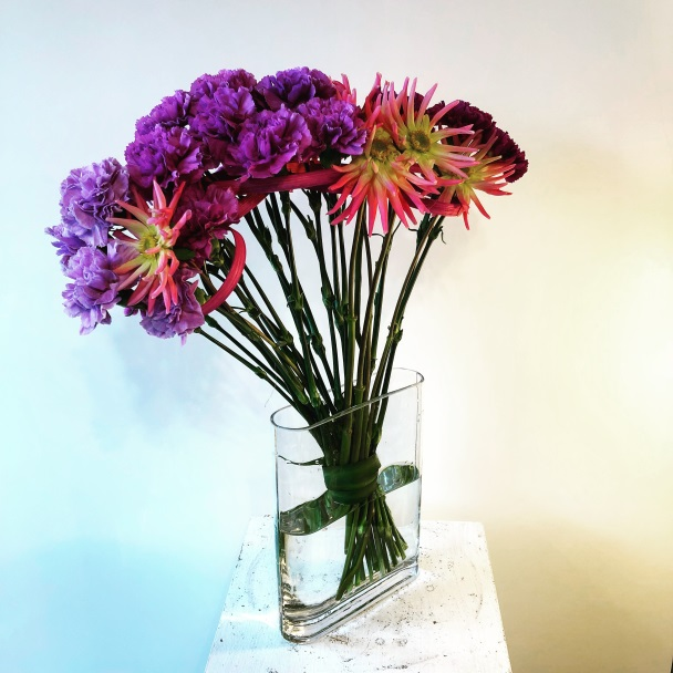 My design for the hand tied bouquet with a low binding point: